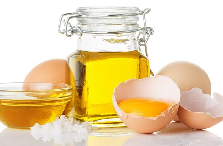 Applying a Paste of Eggs with Coconut Oil