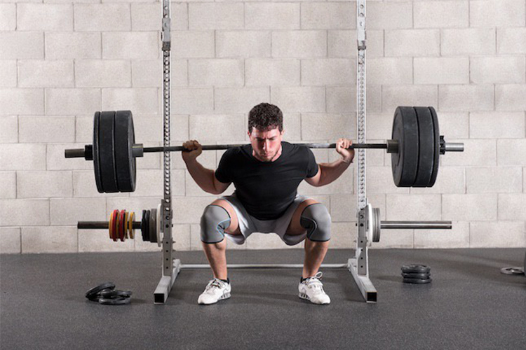 What are the benefits of using a squat rack?